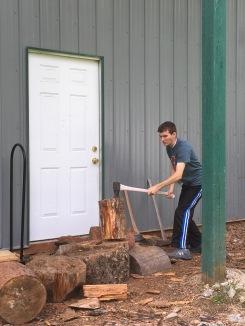 Isaac chopping wood